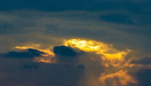 dark sunrise with peaks cropped